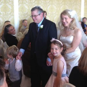 Nanci, yours truly, and my two young ones – Lillian and Daniel – as we recede down the aisle following the wedding ceremony.