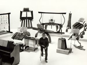 Harry Partch with his instruments