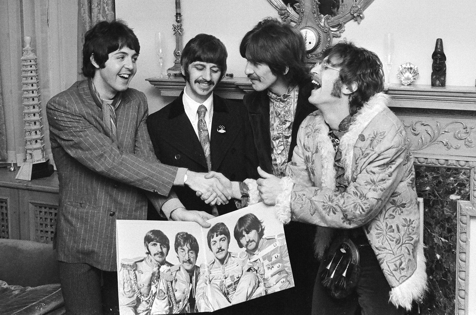 The Beatles with the finished album