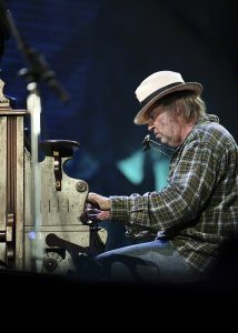 Neil Young performs at Farm Aid in 2010