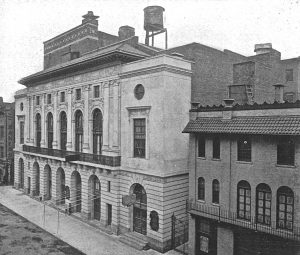 Black and white photograph of the outside of The Globe Theater in New York City