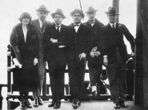 Les Six at the Eiffel Tower in 1921: left-to-right Germaine Tailleferre, Francis Poulenc, Arthur Honegger, Darius Milhaud, the artist Jean Cocteau, and Georges Auric (missing: Louis Durey)