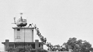 CIA agent helps evacuees onto an Air America on April 29, 1975