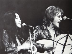 "John and Yoko perform at the ""John Sinclair Freedom Rally"" in the early morning of December 11, 1971"