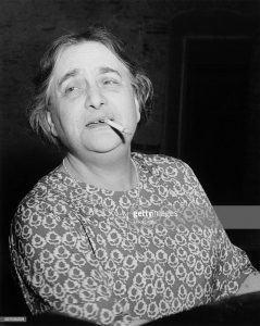 British pianist Myra Hess at piano with Cigarette in Mouth