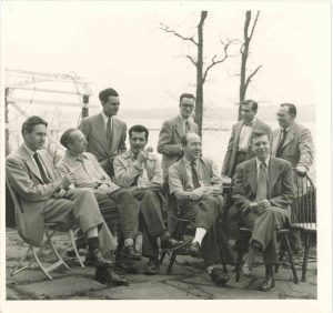Left to right: Gerhard Samuel, Donald Fuller, Arthur Berger, Jerome Moross; seated: Leon Kirchner, Aaron Copland, Israel Citkowitz, David Diamond, Elliot Carter; Palisades, New York; 1949