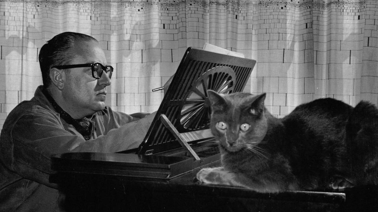 Alberto Ginastera and cat at piano