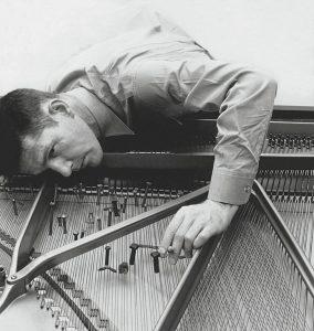 John Cage preparing a piano circa 1950