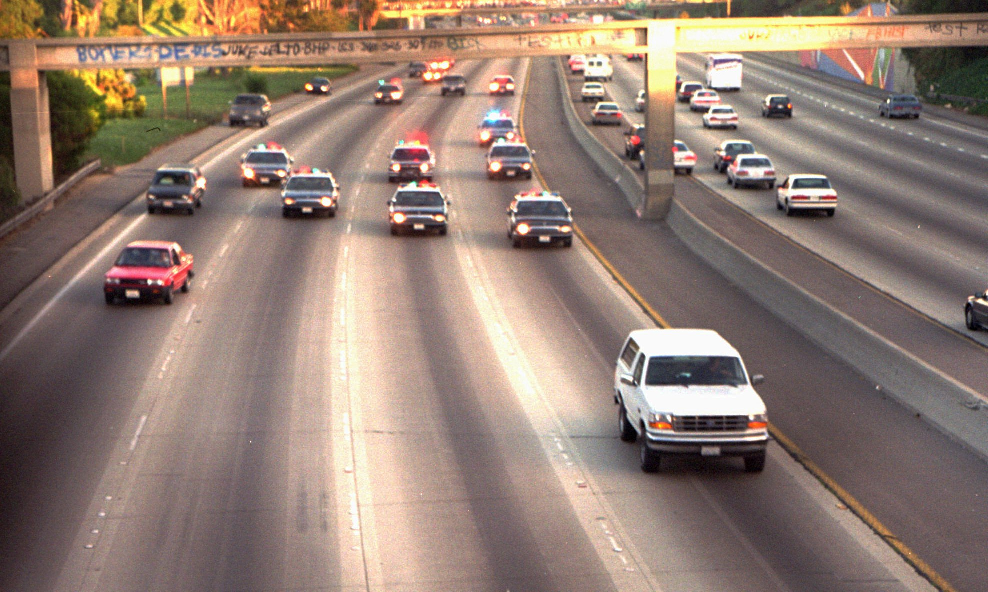 "O.J. Simpson in his white, Ford Bronco being ""chased"" (at rather low speed) by the Los Angeles Police on June 17, 1993"
