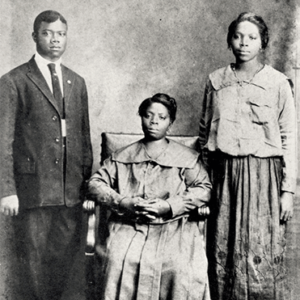 Circa 1918: Louis Armstrong, his mother Mary Albert, and his sister Beatrice