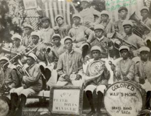 Armstrong (see arrow) circa 1913 in the Colored Waif's Home band
