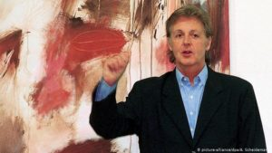 Paul McCartney standing in front of one of his paintings at the Kunstforum Lyz gallery in Siegen, July 1999