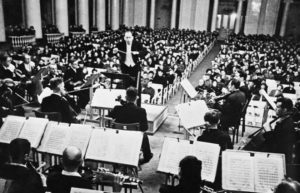 Karl Eliasberg conducting the starving Leningrad Radio Orchestra to a starving audience in a performance of Shostakovich's Symphony No, 7 on August 9, 1942