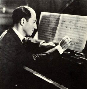 George Gershwin composing at the piano. American composer, 1898-1937.