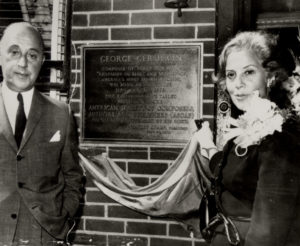 Gershwin's brother Arthur and sister Frances unveil a plaque marking Gershwin's birth at 242 Snediker Avenue, Brooklyn