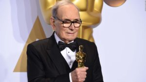 Ennio Morricone on February 28, 2016, holding his Oscar for the soundtrack to Quentin Tarantino's The Hateful Eight