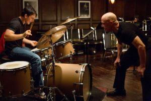 Whiplash: left, Miles Teller as Andrew Neiman; right, J. K. Simmons as Terence Fletcher